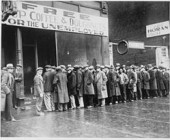 250px-Unemployed_men_queued_outside_a_depression_soup_kitchen_opened_in_Chicago_by_Al_Capone,_02-1931_-_NARA_-_541927