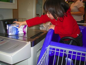 girl in cart self checkout