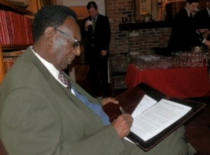 King Kigeli V signs the petition to Pope Francis -- January 23, 2015.