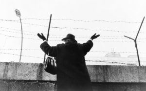 Why the Totalitarian Temptation Lives On After the Berlin Wall